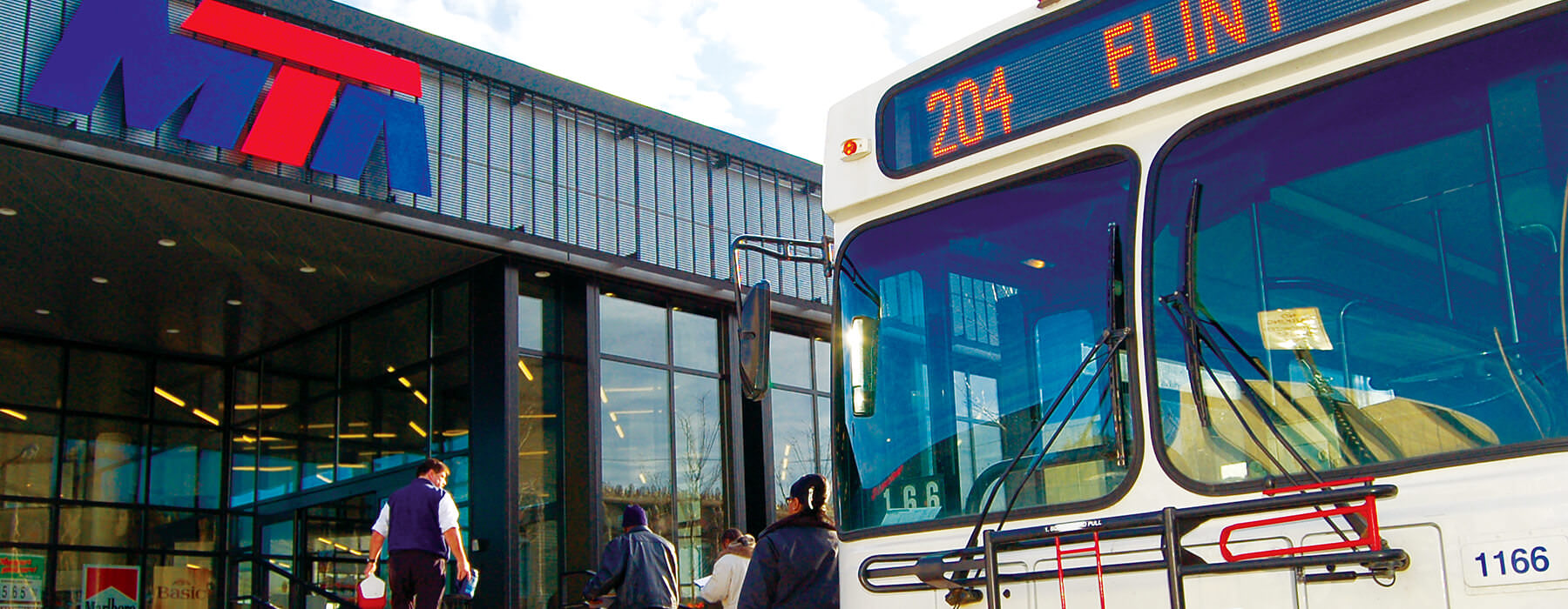 A bus waiting outside a MTA terminal.