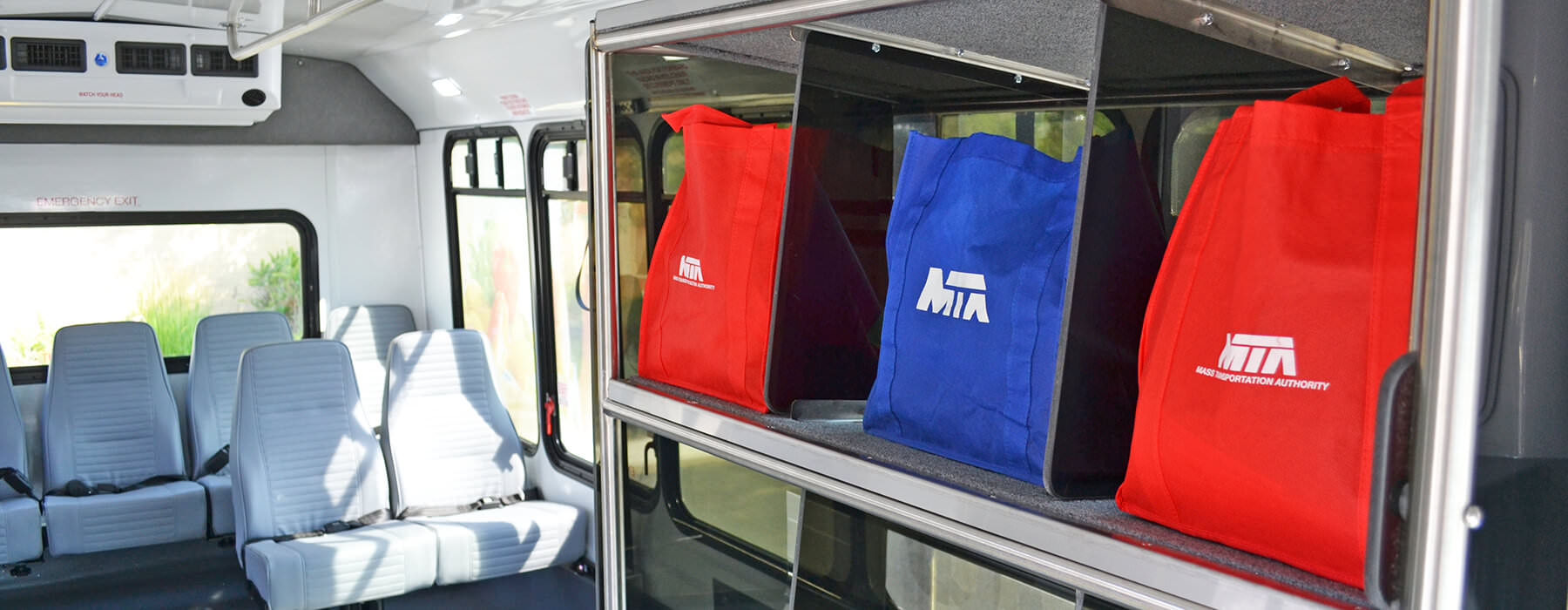 Ride to Groceries bus showing bins to hold grocery bags while traveling.